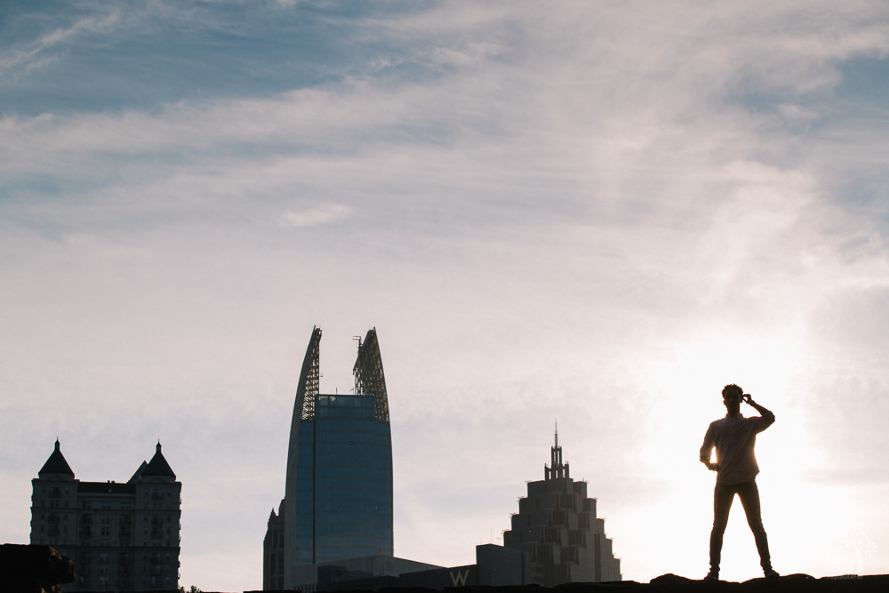 Male silhouette in front of Atlanta skyline