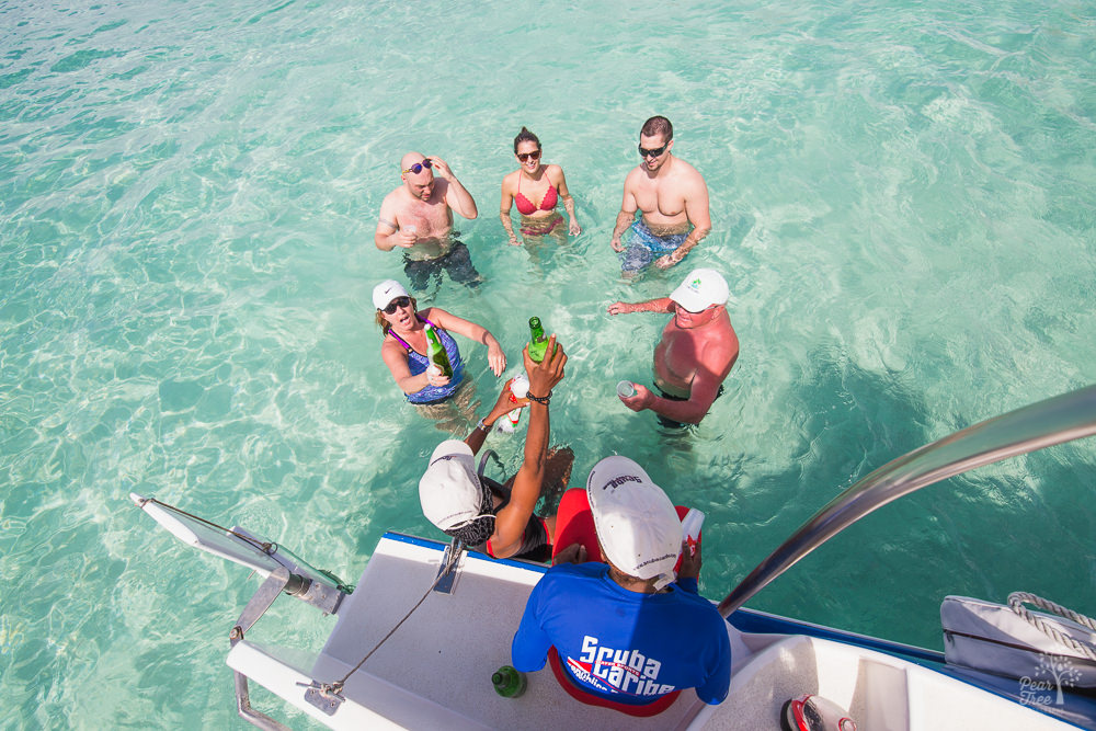 Catamaran crew pouring beers for folks in the Caribbean Sea