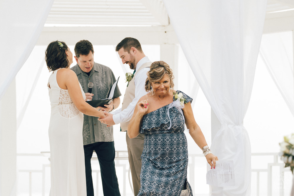 Mom exiting wedding gazebo and trying to be quiet