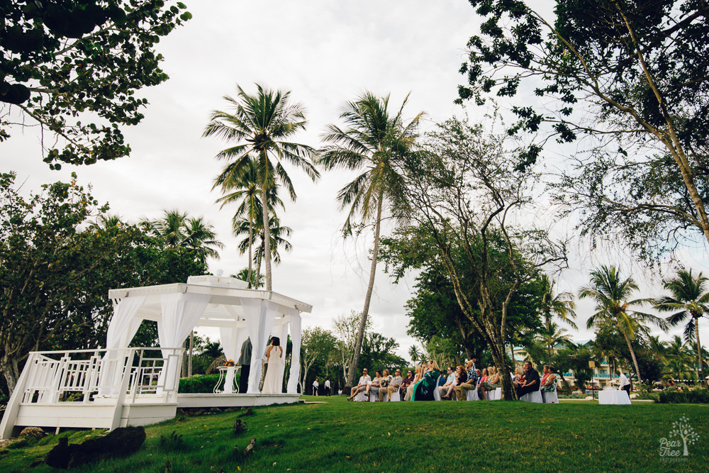 Wedding ceremony in a gazebo surrounded by palm trees in the Dominican Republic