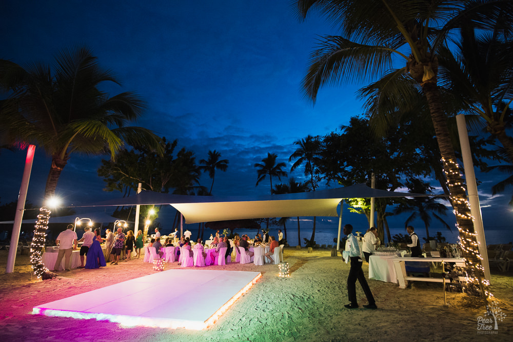 LED lit dance floor on the beach in front of Dominican wedding tent