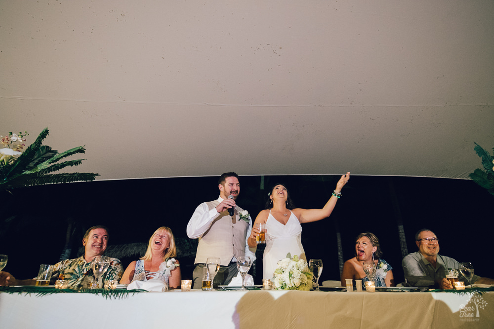Bride and groom giving a speech to guests during the reception