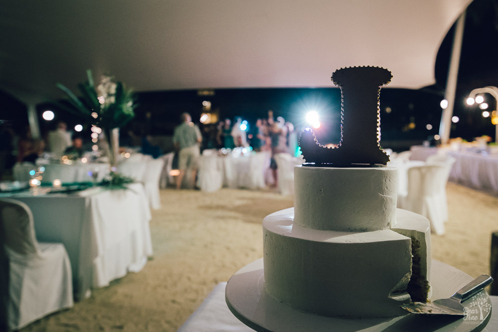 L wedding cake topper at back of tent