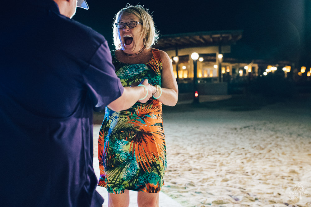 Laughing wedding guest dancing in Dominican Republic