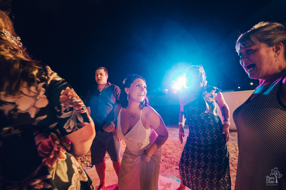 Bride dancing and singing with friends