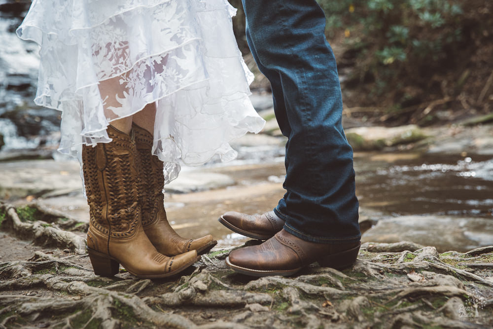 Feet of bride and groom wearing cowboy boots