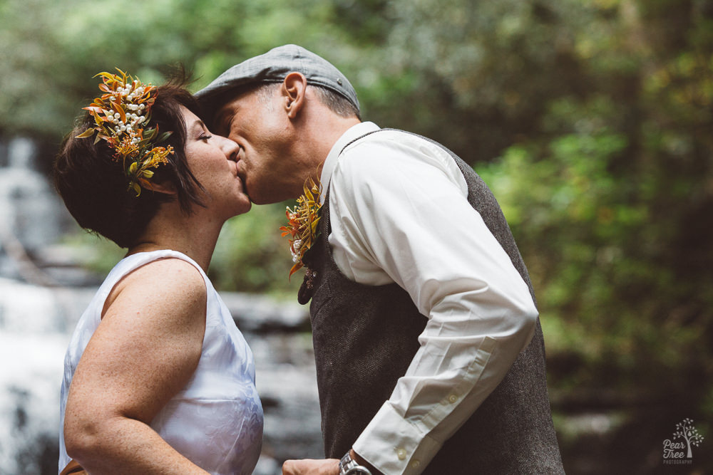 Bride + groom kissing after being pronounced husband and wife
