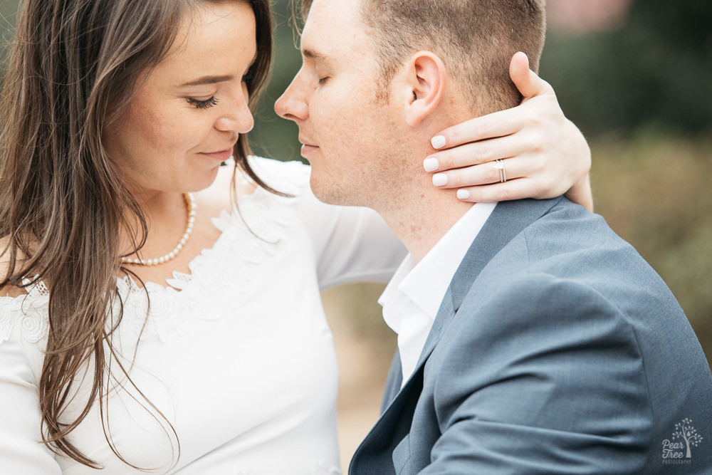 An engaged couple holding each other close