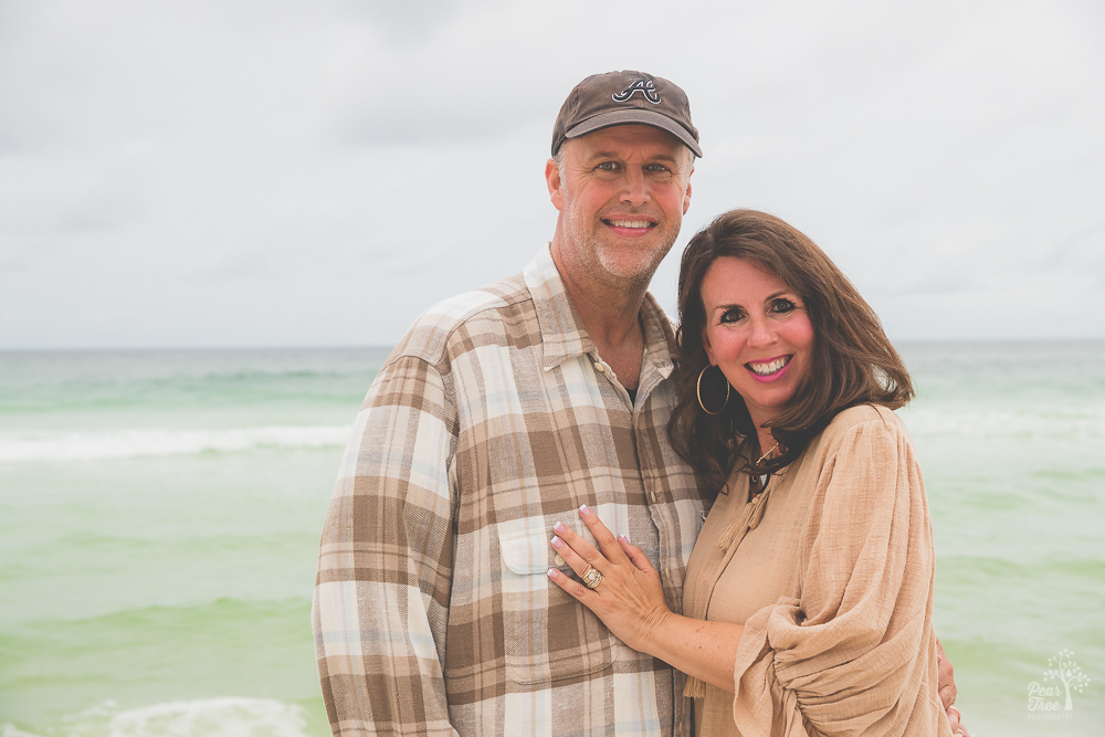 Mom and dad smiling on the beach