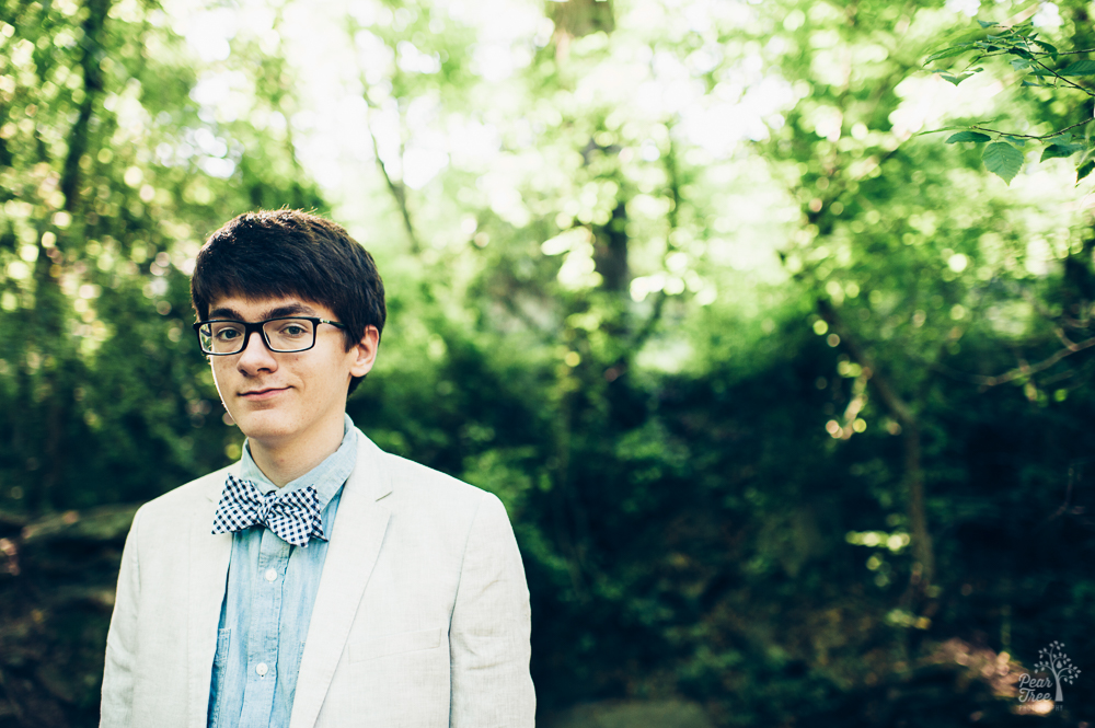 High school senior boy smirking in bow tie