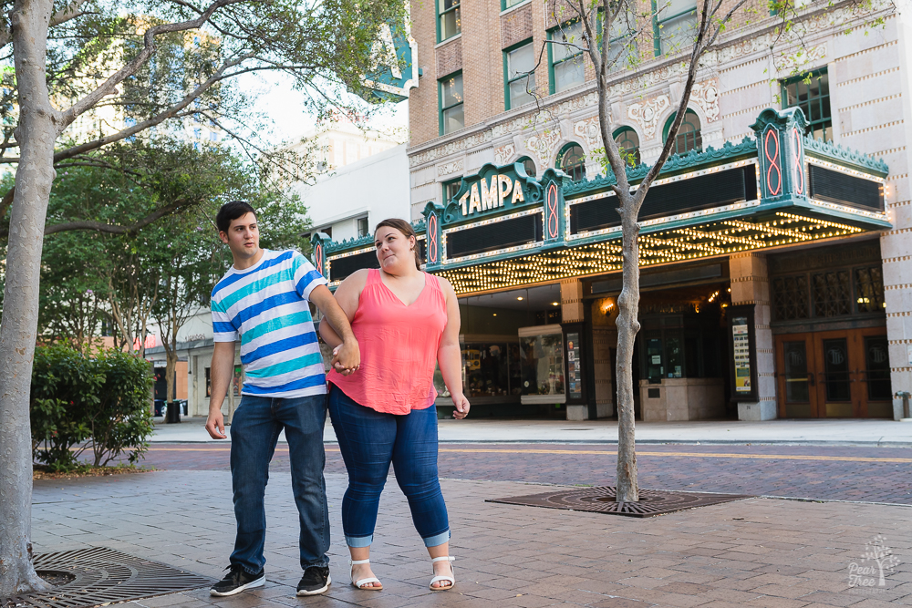 Young married couple dancing in front of Tampa theatre