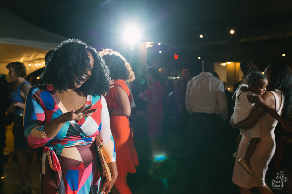 Woman singing and dancing at Urban Tree Cidery wedding reception