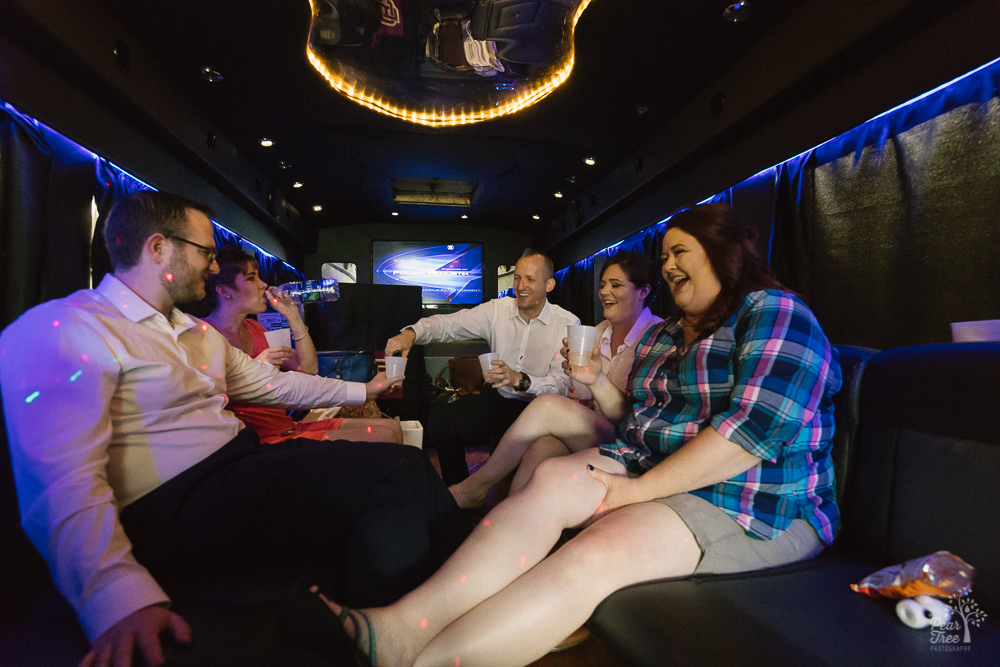 Bride, family, and friends inside a party bus to Macon