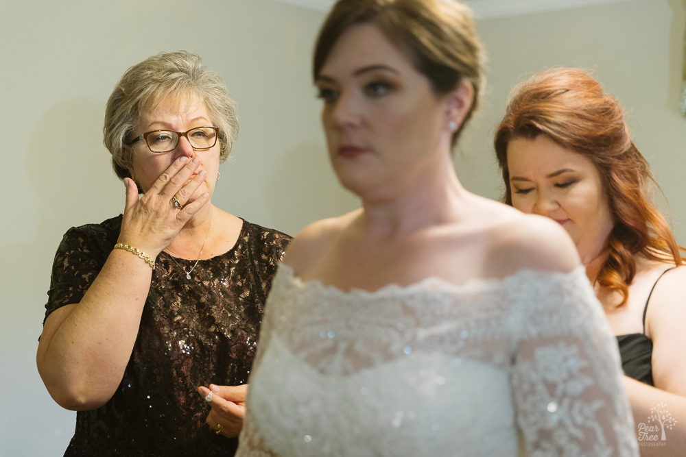 Bride's mother gasping at wedding dress being worn for first time