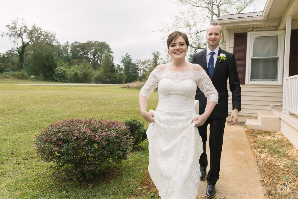 Bride walking out with male attendant